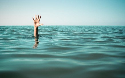Drowning person with hand in the air
